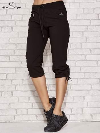 Czarne spodnie dresowe capri z kieszonką