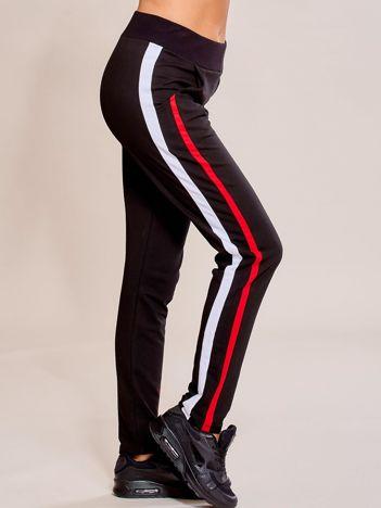 Czarne spodnie dresowe damskie z podwójnymi lampasami