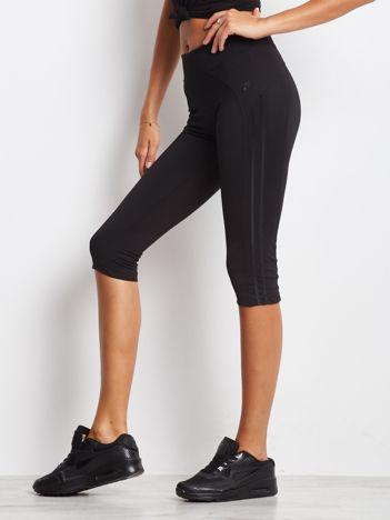 Czarne termoaktywne legginsy do biegania 3/4 z błyszczącymi lampasami ♦ Performance RUN