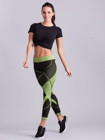 Czarno-zielone legginsy sportowe