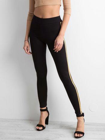 Czarno-złote legginsy z lampasami