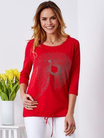 Czerwona bluzka z aplikacją z dżetów
