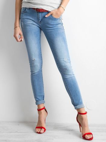 Damskie jeansy z przetarciami niebieskie