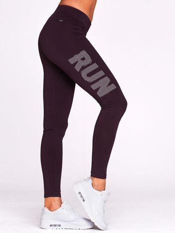 Długie legginsy do biegania z napisem RUN ciemnofioletowe