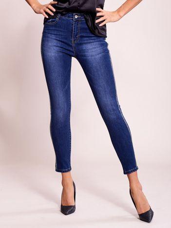 Dopasowane spodnie jeansowe z aplikacją ciemnoniebieskie