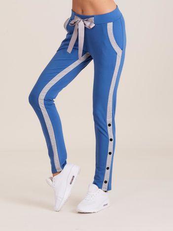 Dresowe spodnie damskie z lampasami niebieskie