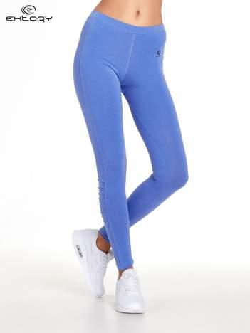 Fioletowe legginsy sportowe z drapowaniem