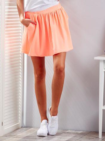 Fluo pomarańczowa rozkloszowana dresowa spódnica z kieszeniami