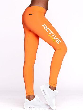 Fluo pomarańczowe legginsy na trening z napisem ACTIVE