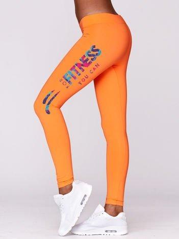 Fluo pomarańczowe legginsy sportowe z fitnessowym nadrukiem
