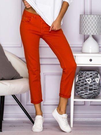 Gładkie spodnie z materiału pomarańczowe
