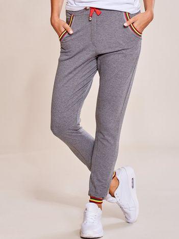 Grafitowe spodnie dresowe damskie rurki z kolorowymi ściągaczami