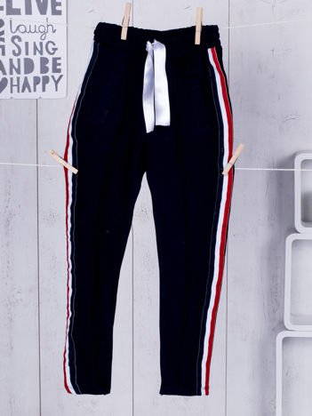 Granatowe dziecięce spodnie dresowe ze wstążką