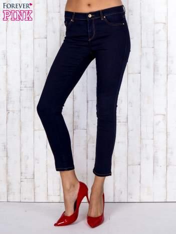 Granatowe jeansowe spodnie skinny z kontrastowymi szwami
