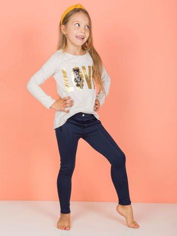 Granatowe legginsy dla dziewczynki z przeszyciami