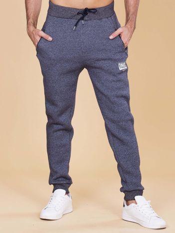 Granatowe ocieplane spodnie dresowe męskie