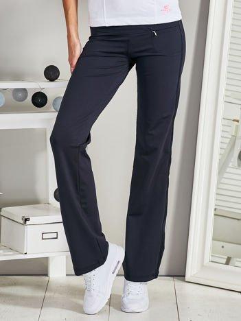 Granatowe spodnie sportowe z aplikacją z dżetów