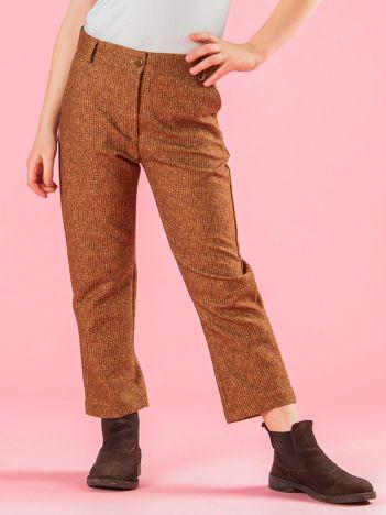 Jasnobrązowe spodnie dziewczęce z dzianinowym nadrukiem