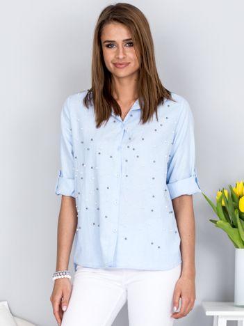 Jasnoniebieska koszula z perełkami