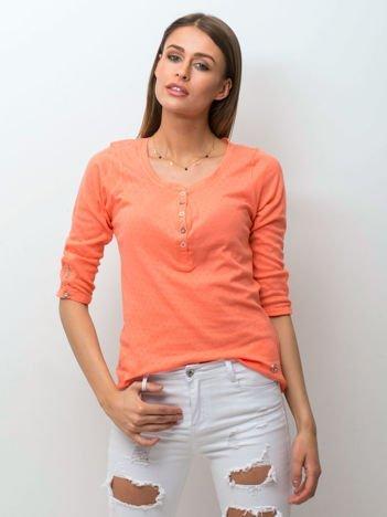 Jasnopomarańczowa bluzka w drobny ażurowy wzór z guzikami