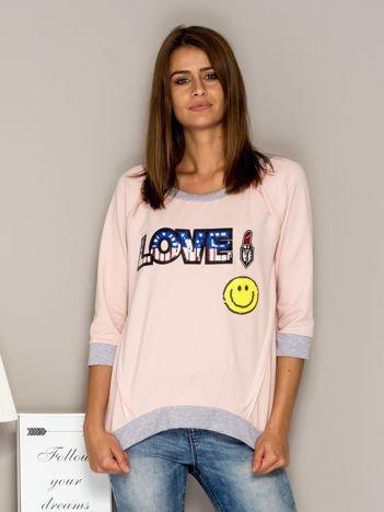 Jasnoróżowa bluza z cekinowym napisem LOVE i kokardami z tyłu
