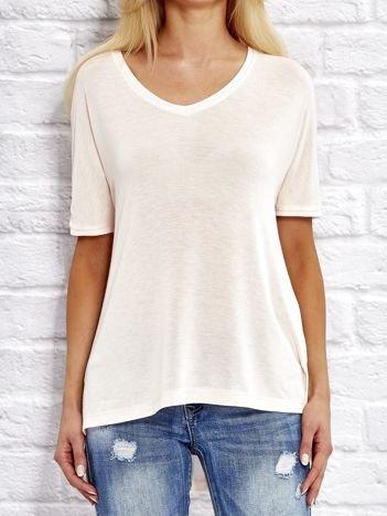 Jasnoróżowa bluzka o kroju oversize