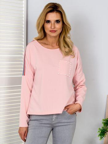 Jasnoróżowa bluzka z lampasami i perełkami