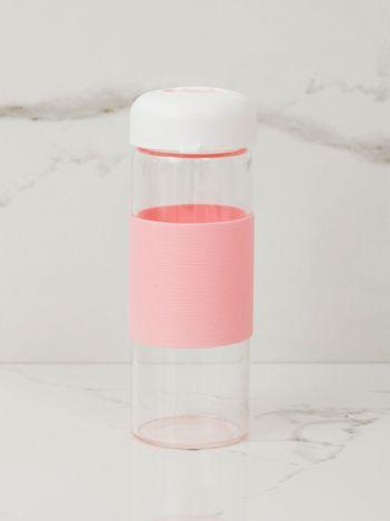Jasnoróżowa szklana butelka