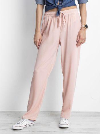 Jasnoróżowe spodnie Inability