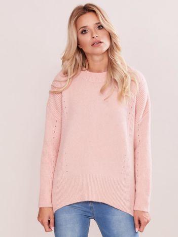 Jasnoróżowy asymetryczny sweter