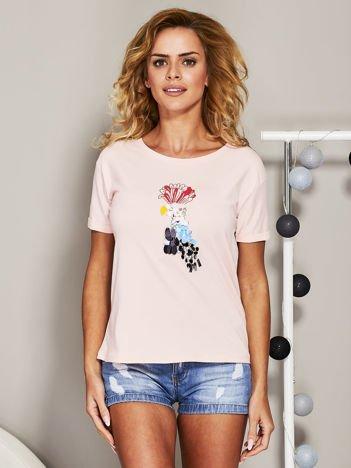 Jasnoróżowy t-shirt z cekinowym ptakiem