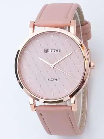 Jasnoróżowy zegarek damski z pikowaniami na tarczy