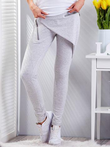 Jasnoszare spodnie dresowe z suwakami