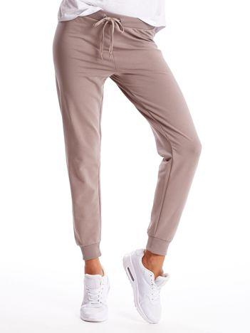 Kawowe spodnie dresowe z troczkami