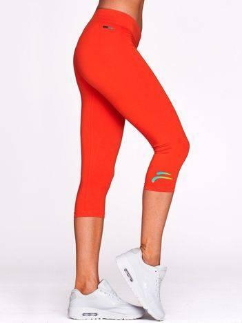 Krótkie legginsy sportowe z logo ciemnopomarańczowe