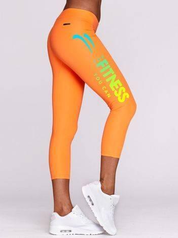 Legginsy do fitnesu z kolorowym nadrukiem FITNESS fluo pomarańczowe