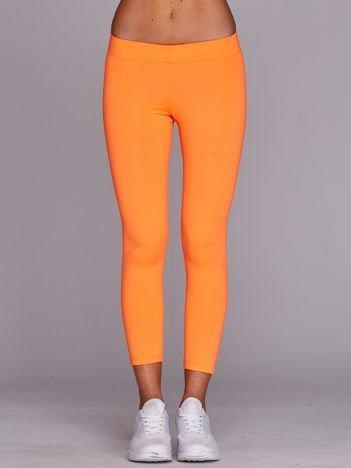 Lekko ocieplane legginsy fitness o długości 3/4 fluo pomarańczowe