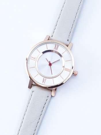 Mały jasnobeżowy zegarek damski