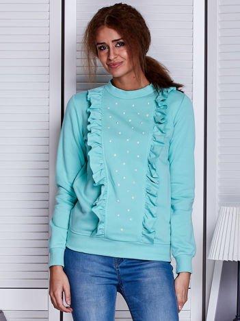 Miętowa bluza z kolorowymi perełkami i falbankami