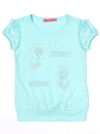 Miętowy t-shirt dla dziewczynki z kwiatami