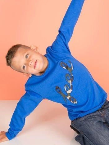 Niebieska bawełniana bluzka dla dziewczynki z moro aplikacją