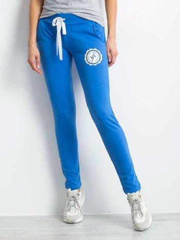 Niebieskie damskie spodnie dresowe z troczkami