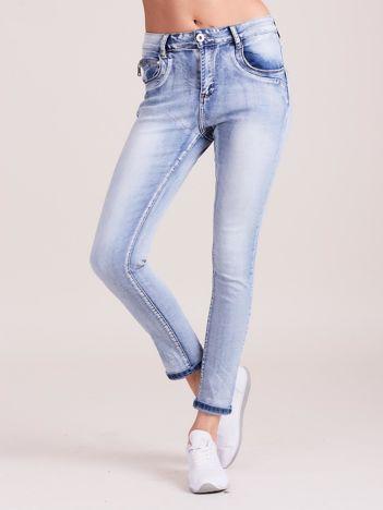 Niebieskie damskie spodnie jeansowe slim