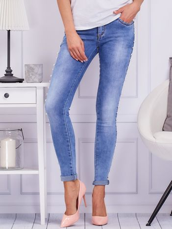 Niebieskie jeansowe spodnie z perełkami