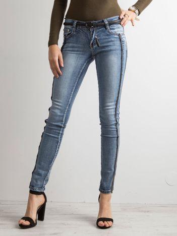 Niebieskie jeansy skinny z suwakami
