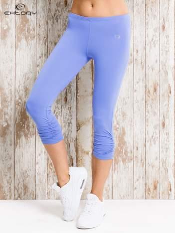 Niebieskie legginsy sportowe z drapowaniem