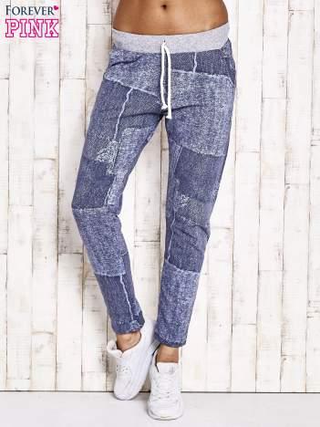 Niebieskie ocieplane spodnie dresowe