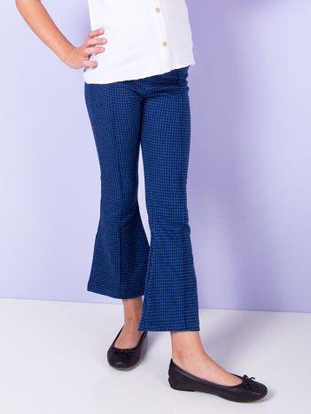 Niebieskie rozszerzane spodnie dla dziewczynki w pepitkę