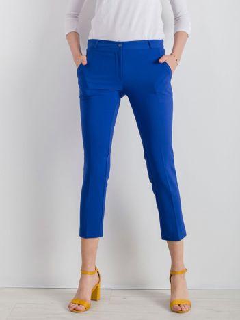 Niebieskie spodnie cygaretki