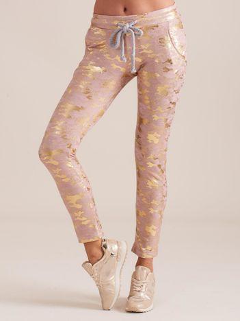 Różowe spodnie dresowe ze złotym printem